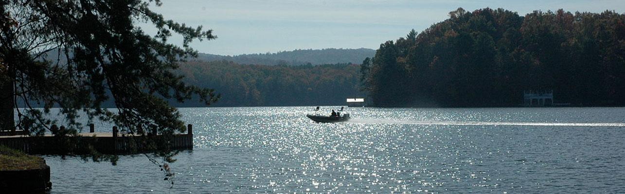 Fishing boat driving on Lake Burton from LaPrade's